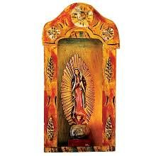 WALL ART:  Handcrafted from pine and detailed by hand, this colorful carving of the Virgin of Guadalupe in an ornamental nicho was fashioned in the tradition of fine Mexican folk art.