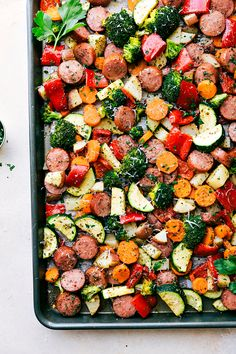One Pan Roasted Garlic Potatoes, Asparagus, Carrots, and Sausage tossed with olive oil and an amazing seasoning mix. Family-friendly, easy weeknight meal!