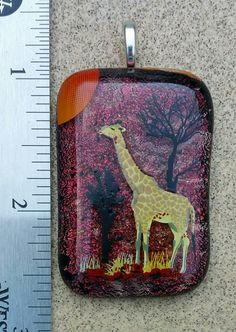 Check out this item in my Etsy shop https://www.etsy.com/listing/450036136/fused-glass-giraffe-scene-jewelry