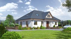 Dom z poddaszem użytkowym o architekturze nawiązującej do tradycji dworów polskich.