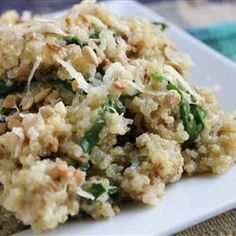 "Cheesy Quinoa Pilaf with Spinach | ""We loved this recipe! Tried it with crumbled goat cheese, pine nuts and fresh lemon. My husband took leftovers to work for lunch. He called and asked if I can make it again for dinner tonight. Thanks for the recipe!"""