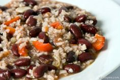 Our recipe for Slow Cooker Red Beans and Rice takes most of the excess fat and calories out to make it nutritiously filling as well as delicious! #redbeans #rice #cleaneating