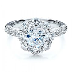 Very feminine! Cluster of Diamonds wedding ring from Joseph Jewelry. Oh my goodness this is the most beautiful ring I think I've ever seen!