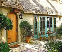 oh yes... I just love the olden day door and the wistful blue of the door frames.  Lovely place to sit and drink a cup of tea