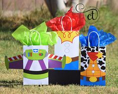 Toy Story Inspired Favor Bags - Bag Size: - Tissue paper not included - - - - - - - - - - - - - - - - - - - - - - - - - - - - - - - - - - - - - - - - - - - - - - - - - - - - - - - - - - - When placing your order, please leave the QTY as 1 (ONE) Pl Toy Story Baby, New Toy Story, Toy Story Theme, Toy Story Birthday, 3rd Birthday Parties, 2nd Birthday, Birthday Treats, Festa Toy Store, Cumple Toy Story