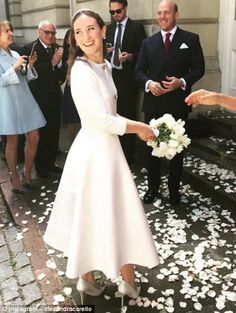First round: The couple legally wed in Chelsea, London, weeks ago...
