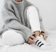 knit sweater, white skinny jeans, white sneakers.