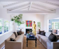 Amber Valletta's Santa Monica Abode - The Living Room from #InStyle - Well, I have a start!  We both own the same Robert Indiana print!