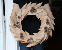 Create this rustic autumn wreath using recycled paper from grocery bags!