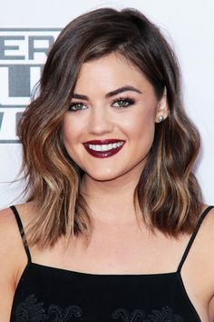 Lucy Hale It's so refreshing to see the Pretty Little Liars star (and country crooner) evolving her personal style. Her fresh long bob, courtesy of Lauren Conrad's glam guru Kristin Ess, looks totally chic, especially when paired with glossy burgundy lips.