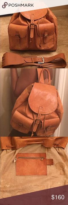 """Clava vachetta tan leather backpack Clava drawstring vachetta tan leather backpack. Buckle closure and two exterior pockets. Main body is lined with zipped inner pocket. Single adjustable shoulder strap. L: 14"""" , H: 15"""" .Preloved has some water stains from use as shown in last two pictures- especially in the lining of the bag - this just requires some cleaning. Open to only reasonable offers  Clava Bags Backpacks"""