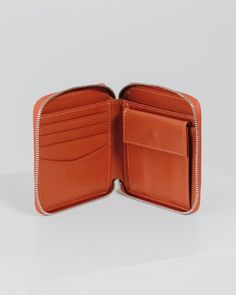 An everyday wallet. **** 4.3 in. W x 4.3 in. H x .8 in. D. Four card slots. Coin pocket with snap closure.Brass zipper.Fine grain leather.  Color:Brick Red