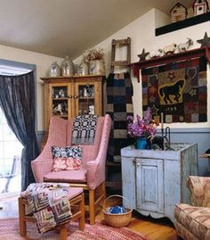 Sooner or Ladder: Take advantage of height in a room with a vaulted ceiling by using a tall antique ladder as a display spot for a rag quilt...