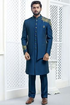 Lending a sharp finish to your wedding-ready looks is this self designed two layered blue colour indowestern sherwani embellished with zari & thread work.This is designer outfit that comes with a embroidered jacket over a sherwani with same colour pants. Wedding Dress Men, Wedding Men, Wedding Suits, Farm Wedding, Wedding Attire, Wedding Couples, Boho Wedding, Wedding Ideas, Mens Sherwani