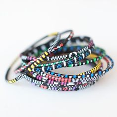 Mali Bangles - Set of 6  Half the price here: http://www.oneworldprojects.com/products/west-african-jewelry.shtml