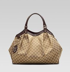 Gucci Sukey Large Tote... Big, roomy and CLASSIC! I have this bag and I ABSOLUTELY LOVE IT!!