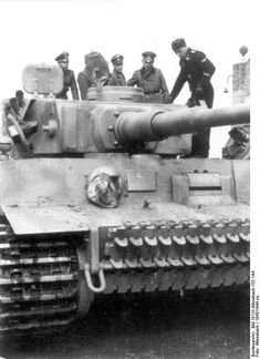 German SS officers inspecting a Tiger I heavy tank, 1943 (Photographer	Wiesebach, German Federal Archive)  #tanks #worldwar2