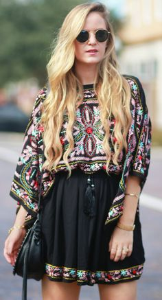 Fall transition boho outfit styled with a black embroidered flowy dress, Rebecca Minkoff saddle bag, and Ray Ban Icon sunglasses