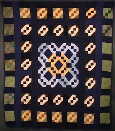 Amish Jacob's Ladder Quilt: Circa 1930; Pennsylvania.  Navy blue sashing sets off the blocks in this unusual design.