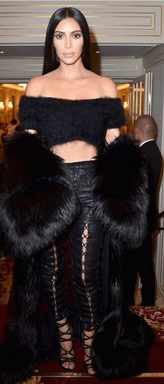 Who made Kim Kardashian's black coat, sandals, and lace up leather pants?