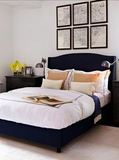 Bedroom. This bedroom is headed by this tall navy blue upholstered and studded headboard. Zinc dressers are used as nightstands. Light silk rug is used to anchor the room and amplify the amount of daylight. #Bedroom