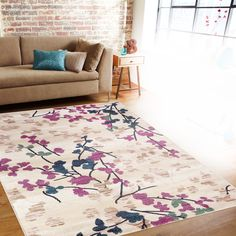Beautiful and unique, this gorgeous rug features an elegant floral paisley pattern in rich hues of navy, purple, and beige. Crafted from high-quality , this floor covering is bound to add a special touch to your home décor.