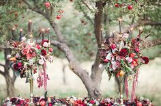 36 Ideas To Throw A Halloween Wedding With Style: #12. Vintage-inspired black and gold candle fixtures with bold fall flowers