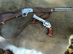 .357 Magnum LeverGun & Revolver - A wonderful combination for a backwoodsman.  Handgun for close defensive work against vermin, and a carbine to boost ballistics for hunting and defense against larger animals.  Load selection is key though - hard cast in the carbine, JSP or JHP in the revolver.