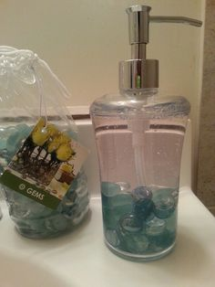 Put glass gems into a clear soap dispenser to add a touch of color to any bathroom. THE BEST PART: You can easily change the color for seasons, add other objects for holidays like snowfkakes or pumpkins....whenever or whatever you like. Try small cars or sparkly gems for kids bathrooms. Great to do as a kid craft too!