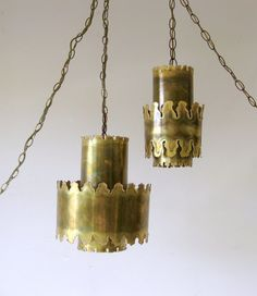 Amazing pair of torch cut brass brutalist hanging pendant or swag lamps by Sven Aage, Holm Sorensen, Denmark. Mid century modern lighting at its