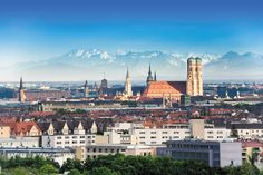 View over Munich and the alps in the back - the big cathedral 'Frauenkirche' and the white tower of the 'New City Hall' with the famous 'Glockenspiel' in the middle   (just around the corner of the HOTEL Mercure München Altstadt)