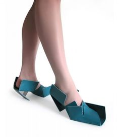 Interestingly enough, theses shoes were  created by the designer's 6 year old, who was trying to do origami