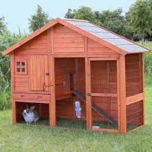 This unique two-story rabbit hutch with gabled roof is ideal for groups of small animals. Pets can roam inside and outside, upstairs and downstairs, in the sun or in the shade while feeling safe and s