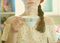 girl, tea: a girl and a cup of steaming tea
