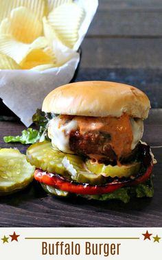 Buffalo Burger Recipe. Ground bison and Mexican chorizo come together for this Buffalo Bill Burger topped with Smoky BBQ Cream Sauce. Layered with caramelized red pepper rings, cheese and some spicy pickles, you've got a burger that will knock your socks off. A healthier grilled burger recipe. #buffalo #bison #burger via @lannisam