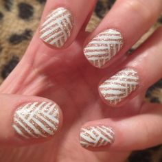 Gold nails with white stripes