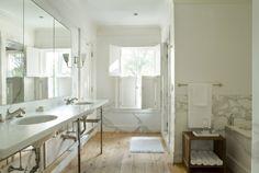Eric Roth Photo - bathrooms - bathroom shutters, shutters in bathroom, marble double washstand, rustic wood floors, plank floors, plank wood floors, white marble backsplash,