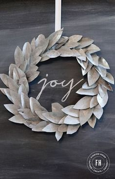 A step by step tutorial to create this stunning and modern take on a Christmas Wreath or for use year round. This DIY galvanized wreath would be beautiful in any home.