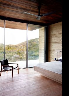 Inspired by its siting, Rammed Earth House takes influence from its context and fuses the natural with the built to create an enviable outlook from its coastal position. Planned Living Architects combines ideas of privacy, protection and immersion to propose a secluded and calming abode. #buildingdesign #kitchenideas #homemakeover #diy #architecture #moderndesignideas #diyideas #amazinghouses #housegoals