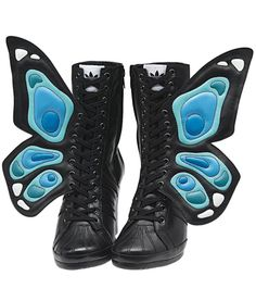 """Jeremy Scott's latest collaboration with Adidas Originals yielded these craaaazy super-high-top wedge sneakers with butterfly wings, due to hit stores in August. I'm actually kind of obsessed with them, but when I asked Amelia if she would wear them she replied, """"Yes. To a rave I went to in 1998."""" Damn, too true. So, what do you think of these silly sneakers? Would you ever wear them?"""