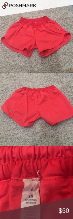 Lululemon tracker shorts! These were only worn once, they were just too small for me! In a red or a pamper coral color, these shorts are perfect for everyday wear or as running athletic shorts! Size 6 lululemon athletica Shorts