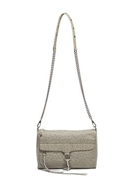 Rebecca Minkoff, I have a bag like this, only the ostrich trim with denim fabric all over. I love this bag! It's my quick go to bag for all day trip.