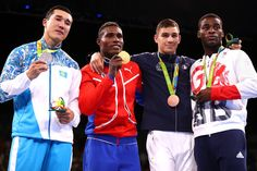 (L-R) Silver medalist Adilbek Niyazymbetov of Kazakhstan, gold medalist Julio Cesar La Cruz of Cuba, bronze medalist Mathieu Albert Daniel Bauderlique of France and bronze medalist Joshua Buatsi of Great Britain stand on the podium during the medal ceremony for the Men's Light Heavy (81kg) Boxing event on Day 13 of the 2016 Rio Olympic Games at Riocentro - Pavilion 6 on August 18, 2016 in Rio de Janeiro, Brazil.