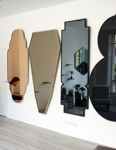 repeating mirrors in unusual shapes from José Lévy -- for a long hallway? (I wouldn't mix tones, but that's me)