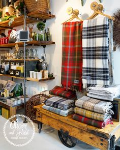 such a perfect way to display blankets.A vintage woodland Christmas. Scarf Display, Fabric Display, Cidades Do Interior, Merchandising Displays, Booth Displays, Retail Displays, Window Displays, Fall Store Displays, Woodland Christmas