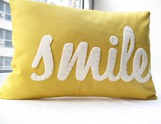 A pillow with a happy message, short and sweet and hopefully contagious. This Smile Pillow in yellow is made from 100% cotton and a beautiful wool felt. The lettering is off centered on this pillow. Create a great set with my other pillows like Love, Happy, Smile or Smile & Relax.