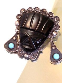 A personal favorite from my Etsy shop https://www.etsy.com/listing/199124535/vintage-mexican-silver-onyx-mask-brooch