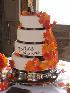 four-tier-round-wedding-cake-with-cascading-leaves-the-leaves-are-made-out-of-gumpaste-and-hand-painted-with-petal-dust super cute!!!!!
