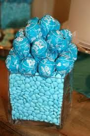 Tiffany blue Blow Pops and jar full of m&ms