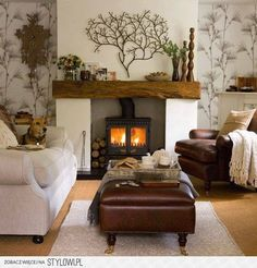Rustic mantle.  comfortable seating.  Vintage Home